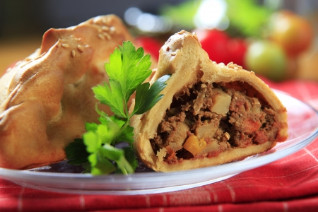 Pastry case filled with meat and vegetables photo