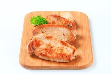 seared: Pan seared pork cutlets on cutting board