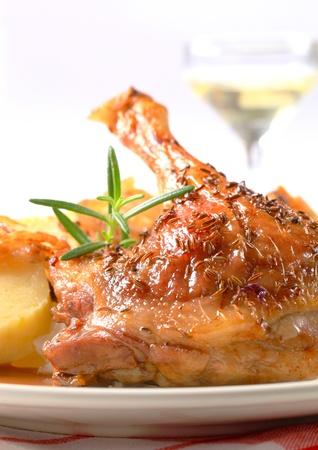 roast duck: Roast duck leg with potato dumplings and white cabbage