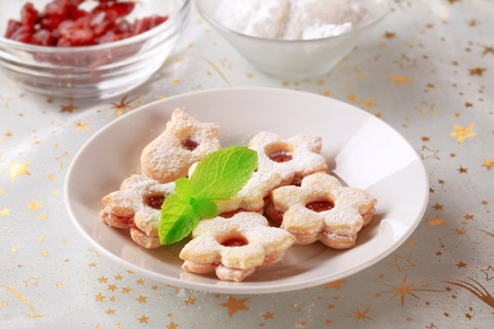 Jam filled cookies sprinkled with icing sugar Stock Photo - 15532729