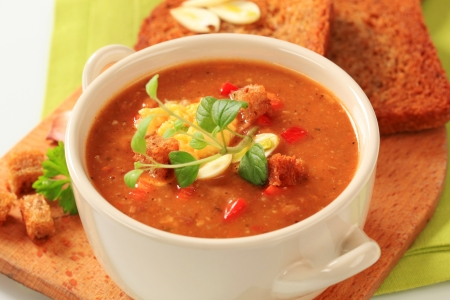 Cup of spicy soup with fried bread photo