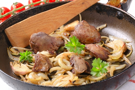 Pan fried chicken liver and onions photo
