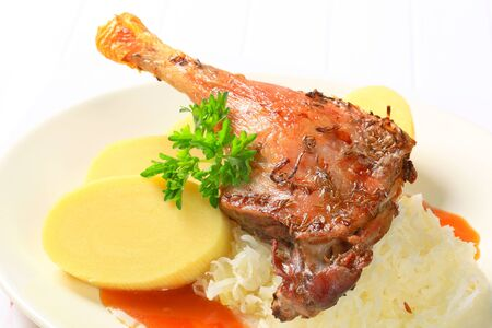 Roast duck leg with potato dumplings and sauerkraut photo