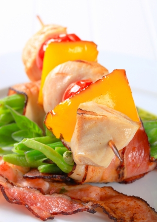Chicken skewer and string beans wrapped in bacon photo