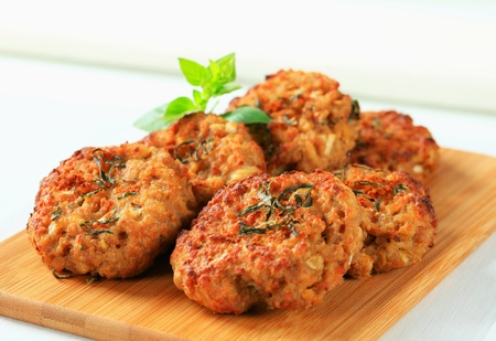 Fried vegetable burgers on cutting board photo