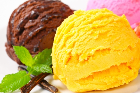 Three scoops of ice cream with different flavors photo