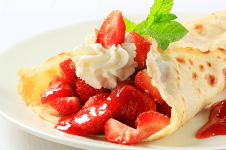 Crepe with fresh strawberries and cream photo