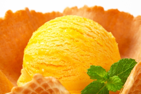 sorbet: Scoop of yellow ice cream in a wafer bowl Stock Photo