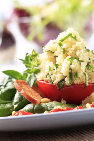kuskus: Vegetarian appetizer - Tomato stuffed with couscous