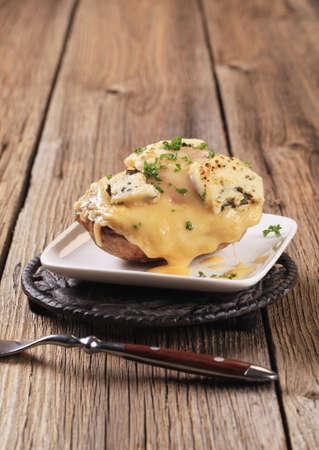 jacket potato: Double cheese twice baked potato sprinkled with parsley Stock Photo