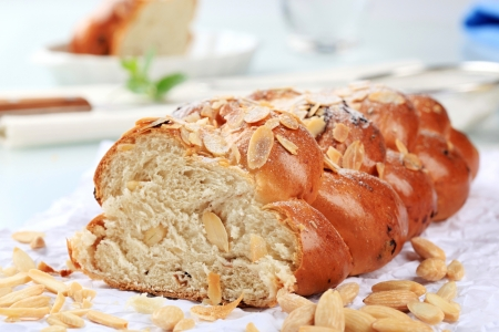 Sweet braided bread with almonds and raisins