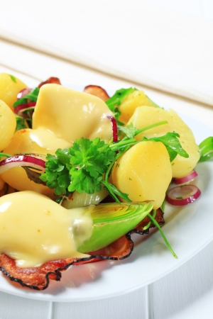 Potato dish served with Hollandaise sauce  photo