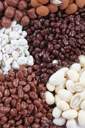 milk chocolate: Assortment of chocolate and yogurt covered nuts and fruit  Stock Photo