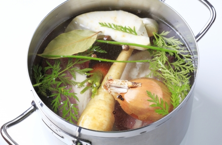 Root vegetables and beef meat in a pot  photo