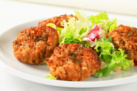 browns: Fried vegetable burgers with green salad