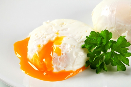 boiled: Two poached eggs on plate