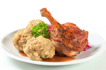 Dish of roast duck leg with Tyrolean dumplings and red cabbage photo