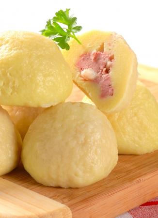 dumpling: Meat stuffed potato dumplings on cutting board