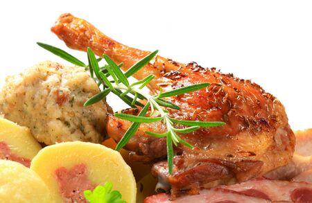 Dish of roast duck leg with dumplings  photo