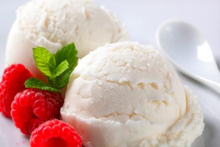 Scoop of creamy ice cream with fresh raspberries photo