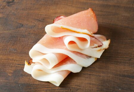 Delicious dry-cured ham sliced paper thin photo