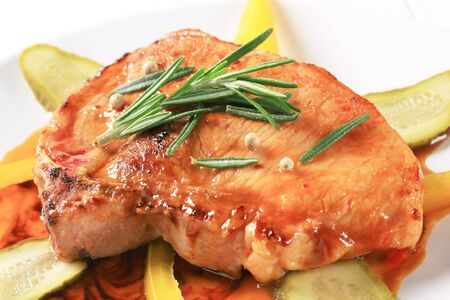 Pan-roasted pork chop in spicy glaze photo