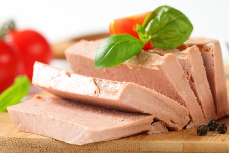 Smooth liver pate on cutting board photo
