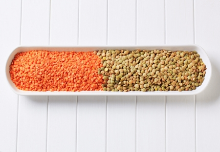 Raw red and brown lentils in a long dish Stock Photo - 17671325