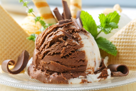 Chocolate vanilla ice cream garnished with wafers and chocolate curls photo