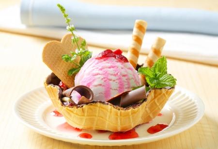 Ice cream served in chocolate coated waffle basket