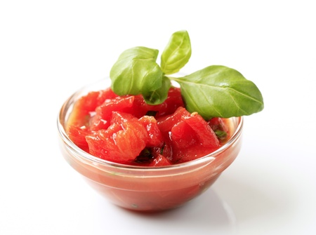 peeled: Bowl of peeled tomatoes with vinaigrette and basil