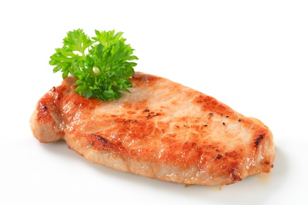 seared: Pan seared pork cutlet isolated on white