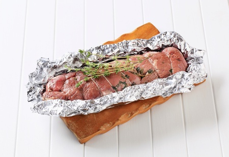 Stuffed meat roulade in tinfoil photo