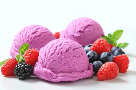 ice cream scoop: Scoops of blueberry ice cream with fresh berry fruit