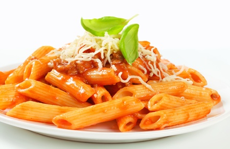 Penne pasta with meat-based tomato sauce and cheese photo
