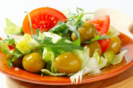 Fresh vegetable salad with green olives photo