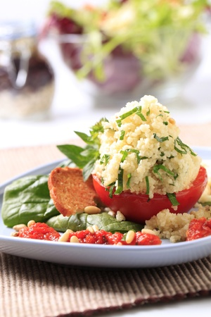 Vegetarian appetizer - Tomato stuffed with couscous photo