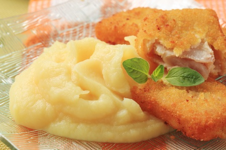 Fried fish fillets served with mashed potato photo