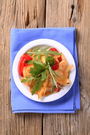 Sheet pasta with tomatoes and salad greens  photo