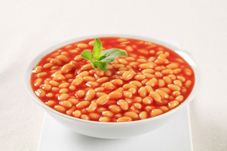 White beans stewed in tomato sauce photo
