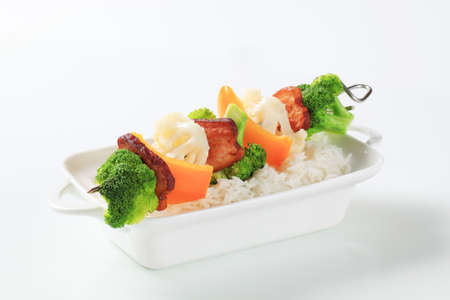 belly pepper: Vegetable skewer with slices of bacon and white rice