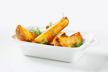 wedges: Roasted potato wedges garnished with fresh dill