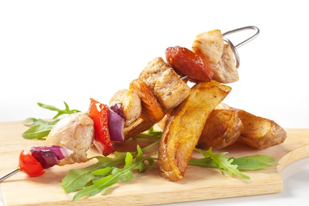 Chicken Shish kebab and roasted potato wedges photo