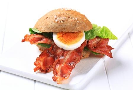 streaky: Bread bun with strips of crispy bacon