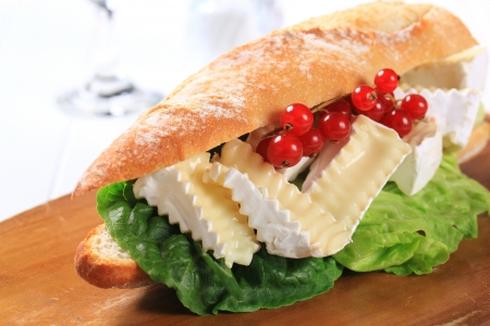 camembert: Sub sandwich with white rind cheese and lettuce