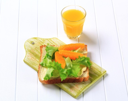 Healthy sandwich and glass of orange juice photo