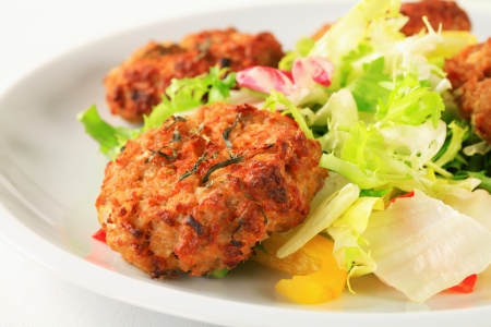 Fried vegetable burgers with green salad photo