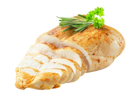 Sliced garlic-rubbed chicken isolated on white