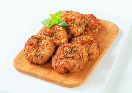browns: Fried vegetable burgers on cutting board
