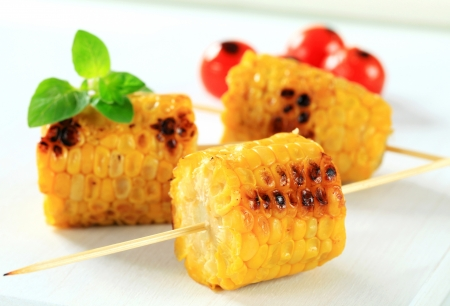 wood stick: Grilled corn on the cob  Stock Photo